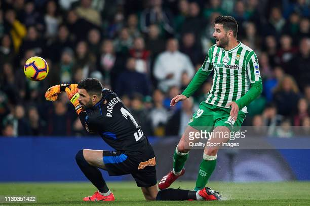 Antonio Barragan of Real Betis competes for the ball with Fernando Pacheco of Deportivo Alaves during the La Liga match between Real Betis Balompie...