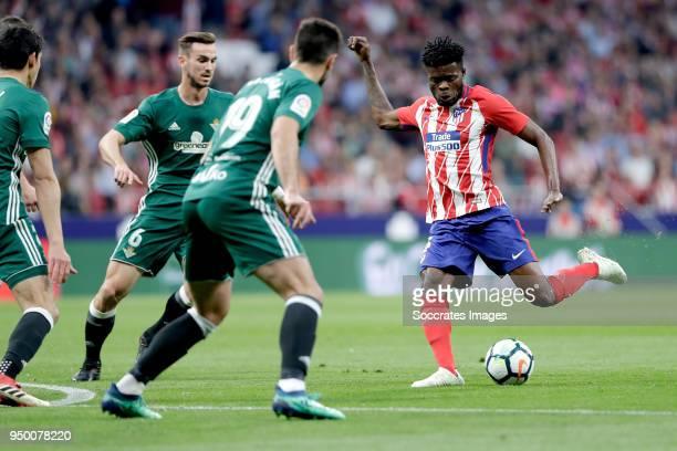 Antonio Barragan of Real Betis Thomas Partey of Atletico Madrid during the La Liga Santander match between Atletico Madrid v Real Betis Sevilla at...