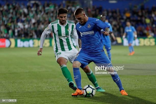 Antonio Barragan of Real Betis, Vitorino Antunes of Getafe during the La Liga Santander match between Getafe v Real Betis at the Coliseum Alfonso...