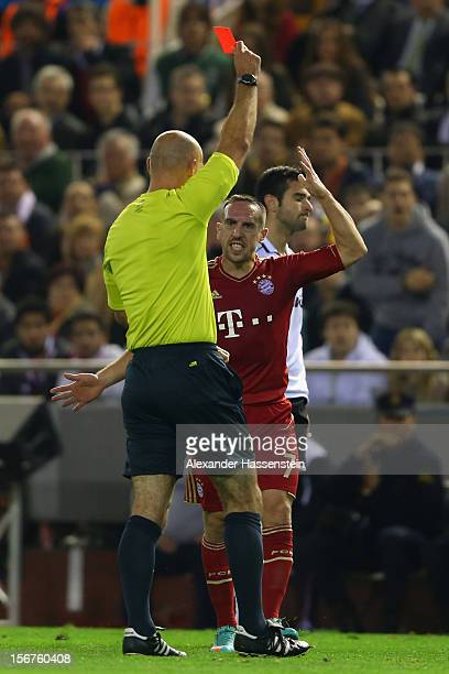 Antonio Barragan of Valencia receives the Red card from referee Howard Webb during the UEFA Champions League group F match between Valencia FC and FC...