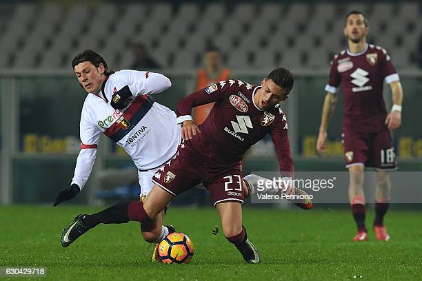 Antonio Barreca of FC Torino clashes with Nikola Ninkovic of Genoa CFC during the Serie A match between FC Torino and Genoa CFC at Stadio Olimpico di...