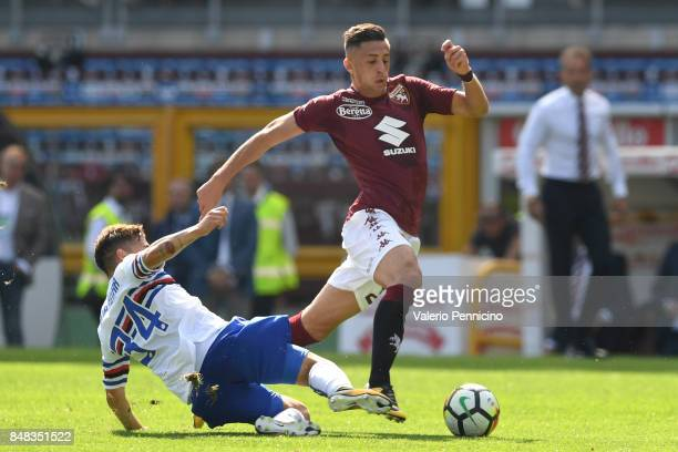 Antonio Barreca of Torino FC is tackled by Bartosz Bereszynski of UC Sampdoria during the Serie A match between Torino FC and UC Sampdoria at Stadio...