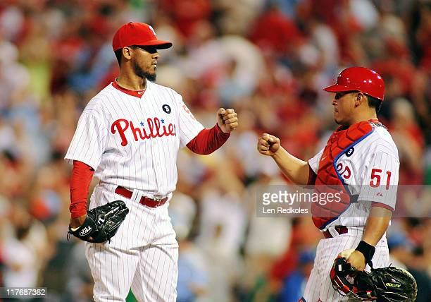 Antonio Bastardo and Carlso Ruiz of the Philadelphia Phillies celebrate a 21 win against the Boston Red Sox at Citizens Bank Park on June 29 2011 in...