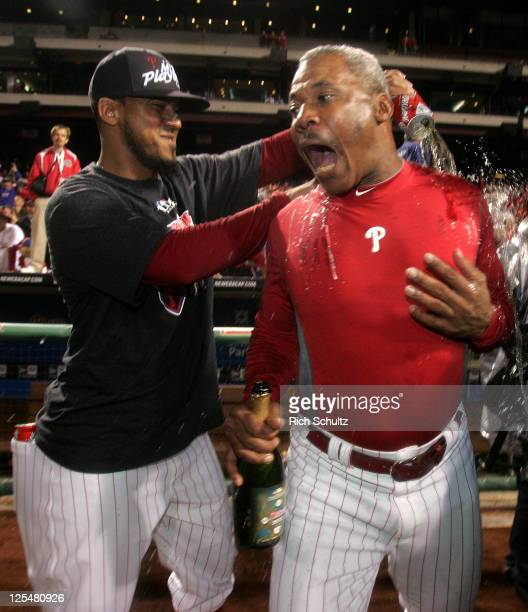 Antonio Bastardo of the Philadelphia Phillies soaks third base coach Juan Samuel with beer after defeating the St Louis Cardinals 92 and clinch the...