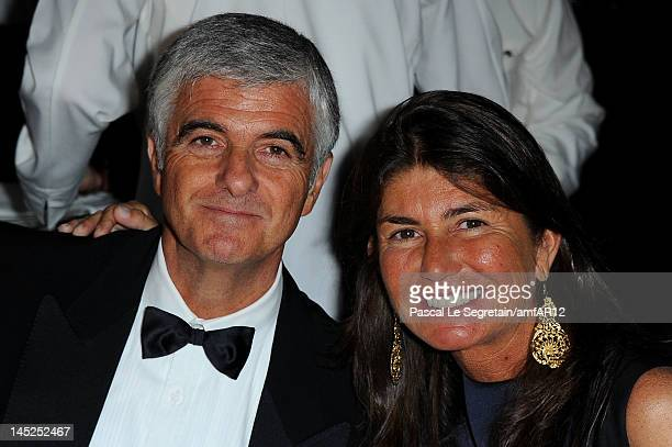Antonio Belloni Group Managing Director and Director LVMH and wife attend the 2012 amfAR's Cinema Against AIDS during the 65th Annual Cannes Film...