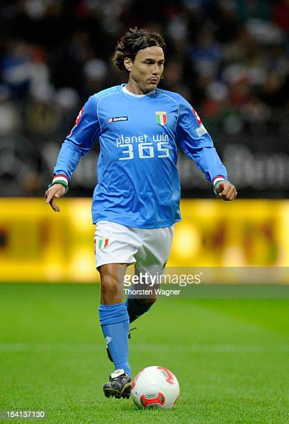 Antonio Benarrivo of Italy runs with the ball during the century match between Germany and Italy at Commerzbank Arena on October 14 2012 in Frankfurt...