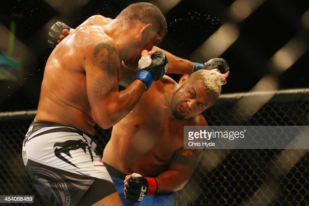 Antonio 'Big Foot' Silva of Brazil and Mark Hunt exchange punches during the UFC Brisbane bout between Mark Hunt and Antonio 'Big Foot' Silva of...