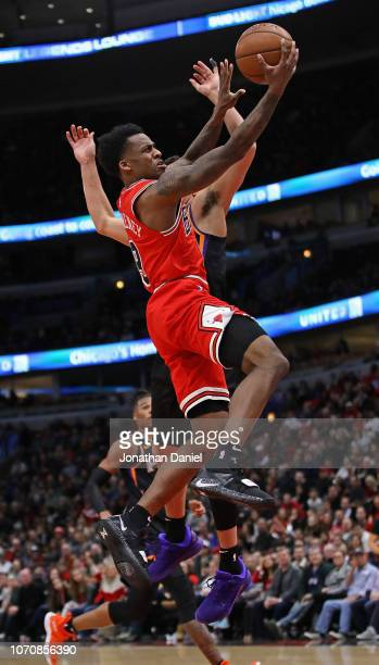 Antonio Blakeney of the Chicago Bulls drives to the basket past Devin Booker of the Phoenix Suns at the United Center on November 21 2018 in Chicago...