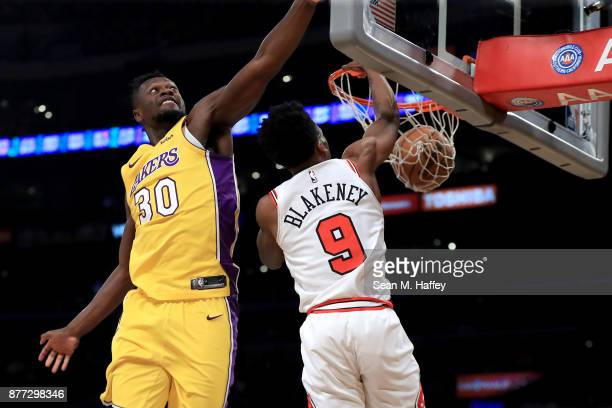 Antonio Blakeney of the Chicago Bulls dunks past Julius Randle of the Los Angeles Lakers during the first half of a game at Staples Center on...