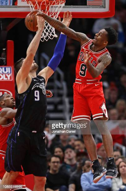 Antonio Blakeney of the Chicago Bulls leaps to knock the ball away from Nikola Vucevic of the Orlando Magic at United Center on December 21 2018 in...