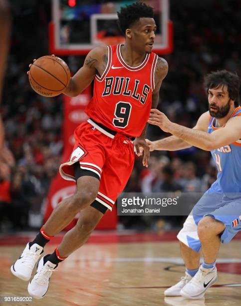 Antonio Blakeney of the Chicago Bulls moves around Milos Teodosic of the LA Clippers at the United Center on March 13 2018 in Chicago Illinois The...