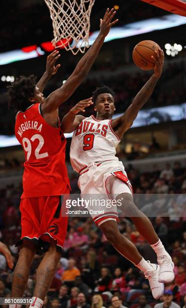 Antonio Blakeney of the Chicago Bulls puts up a shot against Lucas Nogueira of the Toronto Raptors during a preseason game at the United Center on...