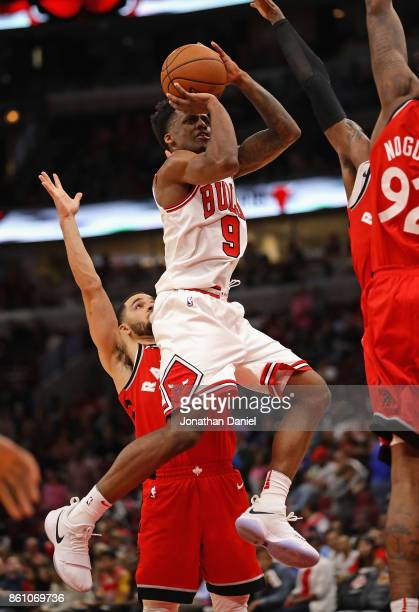 Antonio Blakeney of the Chicago Bulls puts up a shot in front of Fred Van Vleet of the Toronto Raptors during a preseason game at the United Center...