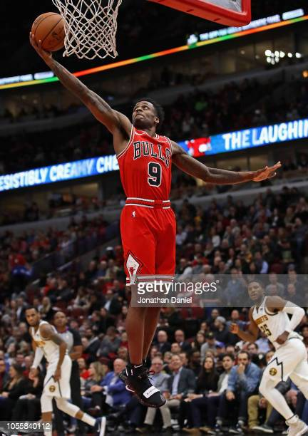 Antonio Blakeney of the Chicago Bulls rebounds against the Denver Nuggets at the United Center on October 31 2018 in Chicago Illinois NOTE TO USER...