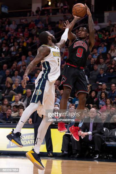 Antonio Blakeney of the Chicago Bulls shoots over Will Barton of the Denver Nuggets at Pepsi Center on November 30 2017 in Denver Colorado NOTE TO...