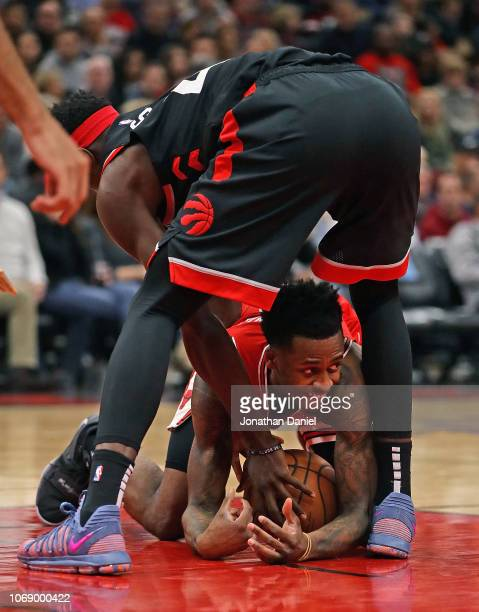 Antonio Blakeney of the Chicago Bulls tries to keep control of the ball under Pascal Siakam of the Toronto Raptors at United Center on November 17...