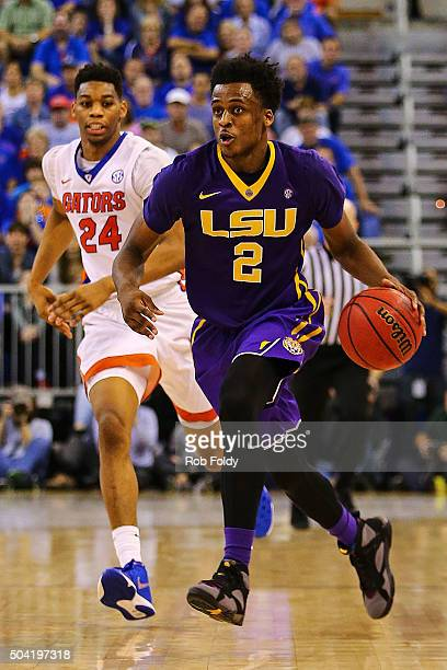 Antonio Blakeney of the LSU Tigers is defended by Justin Leon of the Florida Gators during the second half of the game at Stephen C O'Connell Center...