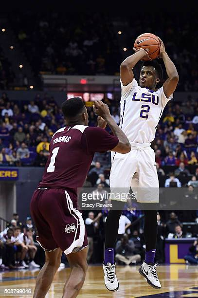 Antonio Blakeney of the LSU Tigers shoots over Fred Thomas of the Mississippi State Bulldogs during the second half of a game at the Pete Maravich...