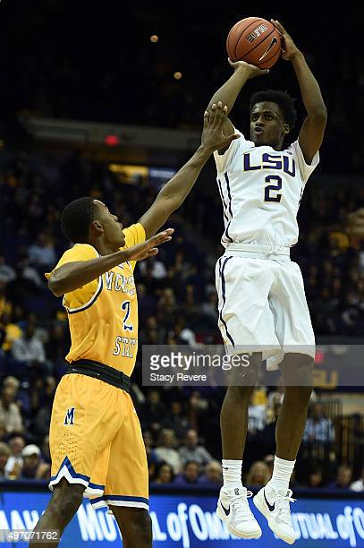 Antonio Blakeney of the LSU Tigers shoots over James Harvey of the McNeese State Cowboys during the first half of a game at the Pete Maravich...