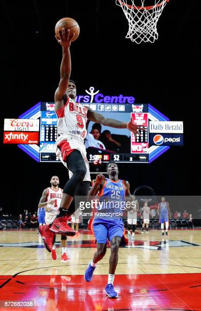 Antonio Blakeney of the Windy City Bulls goes to the basket against Daniel Hamilton of the Oklahoma City Blue during the first half of an NBA GLeague...