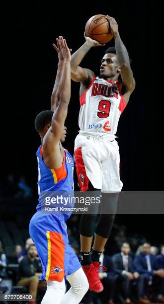 Antonio Blakeney of the Windy City Bulls shoots against PJ Dozier of the Oklahoma City Blueduring the second half of an NBA GLeague game on November...