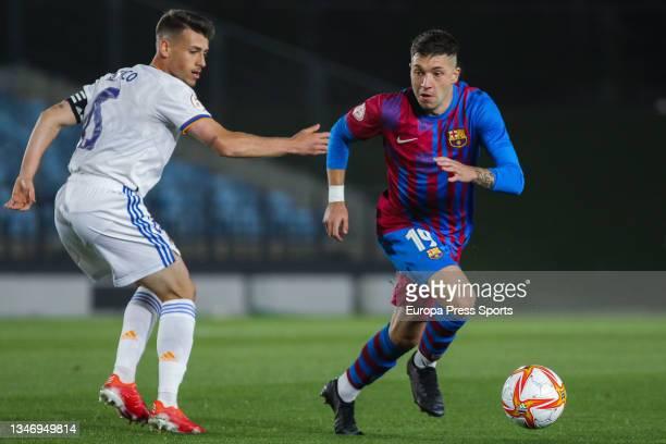 Antonio Blanco of Real Madrid Castilla and Antonio Aranda of FC Barcelona B in action during Primera RFEF Group 2 football match played between Real...
