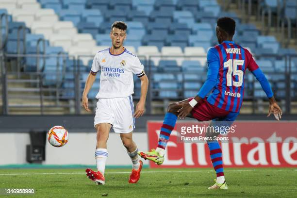 Antonio Blanco of Real Madrid Castilla and Moussa Ndiaye of FC Barcelona B in action during Primera RFEF Group 2 football match played between Real...