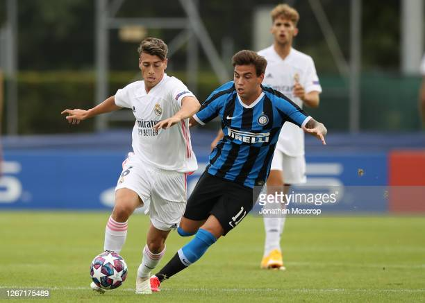 Antonio Blanco of Real Madrid holds off Matias Fonseca of Internazionale during the UEFA Youth League Quarter Final match between Internazionale and...