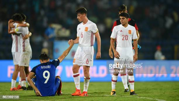 Antonio Blanco of Spain comforts Amine Gouiri of France during the FIFA U17 World Cup India 2017 Round of 16 match between France and Spain at Indira...