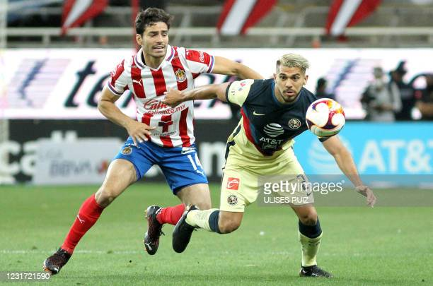 Antonio Briseno of Guadalajara vies for the ball with Henry Martin of America during their Mexican Clausura football tournament match at the Akron...