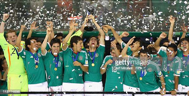 Antonio Briseno of Mexico lifts the trophy after beating Uruguay 2-0 in the FIFA U-17 World Cup Mexico 2011 Final at the Azteca Stadium on July 10,...