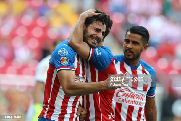 Antonio Briseño of Chivas celebrates with teammates after scoring the first goal of his team during the 2nd round match between Chivas and Tigres...