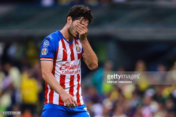 Antonio Briseño of Chivas gets out the field after he get expelled during the 12th round match between America and Chivas as part of the Torneo...