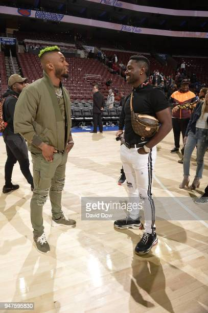 Antonio Brown and Jalen Mills speak after the game between Miami Heat and Philadelphia 76ers in Game Two of Round One of the 2018 NBA Playoffs on...
