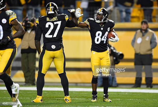 Antonio Brown celebrates his touchdown with LeGarrette Blount of the Pittsburgh Steelers during the fourth quarter against the Baltimore Ravens at...