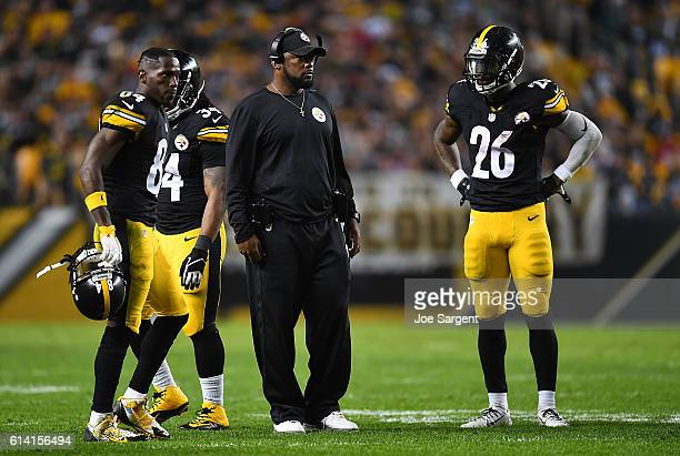Antonio Brown looks on alongside head coach Mike Tomlin and Le'Veon Bell of the Pittsburgh Steelers during the game against the Kansas City Chiefs at...