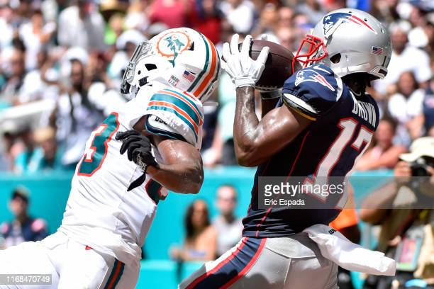 Antonio Brown of the New England Patriots catches a touchdown in the second quarter of the game against the Miami Dolphins at Hard Rock Stadium on...