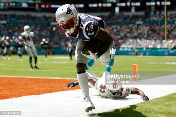 Antonio Brown of the New England Patriots scores a 20 yard touchdown thrown by Tom Brady against the Miami Dolphins during the second quarter in the...