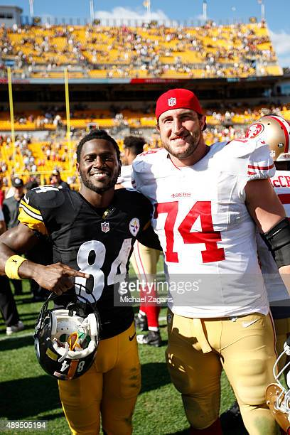 Antonio Brown of the Pittsburgh Steelers and Joe Staley of the San Francisco 49ers stand on the field following the game at Heinz Field on September...