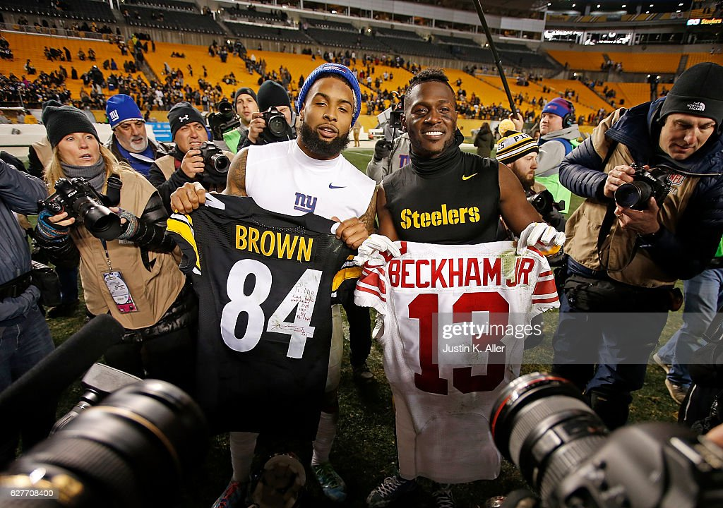 Antonio Brown #84 of the Pittsburgh Steelers and Odell Beckham #13 of the New York Giants pose with jerseys they exchanged with each other at the conclusion of the Pittsburgh Steelers 24-14 win over the New York Giants at Heinz Field on December 4, 2016 in Pittsburgh, Pennsylvania.