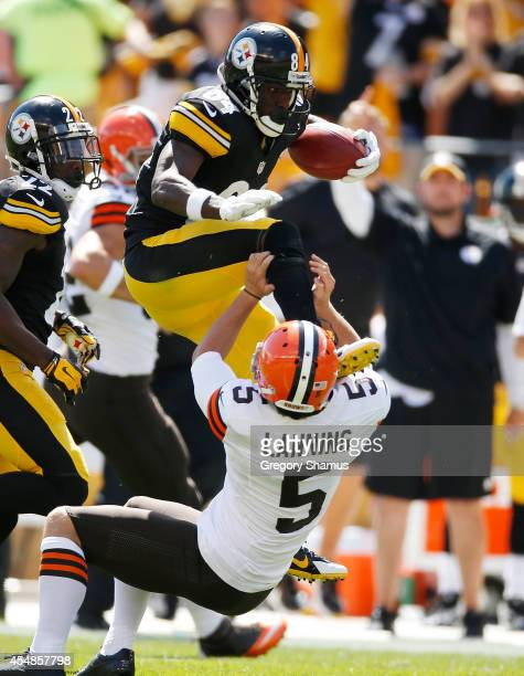 Antonio Brown of the Pittsburgh Steelers attempts to hurdle Spencer Lanning of the Cleveland Browns and gets an unnecessary roughness penalty during...