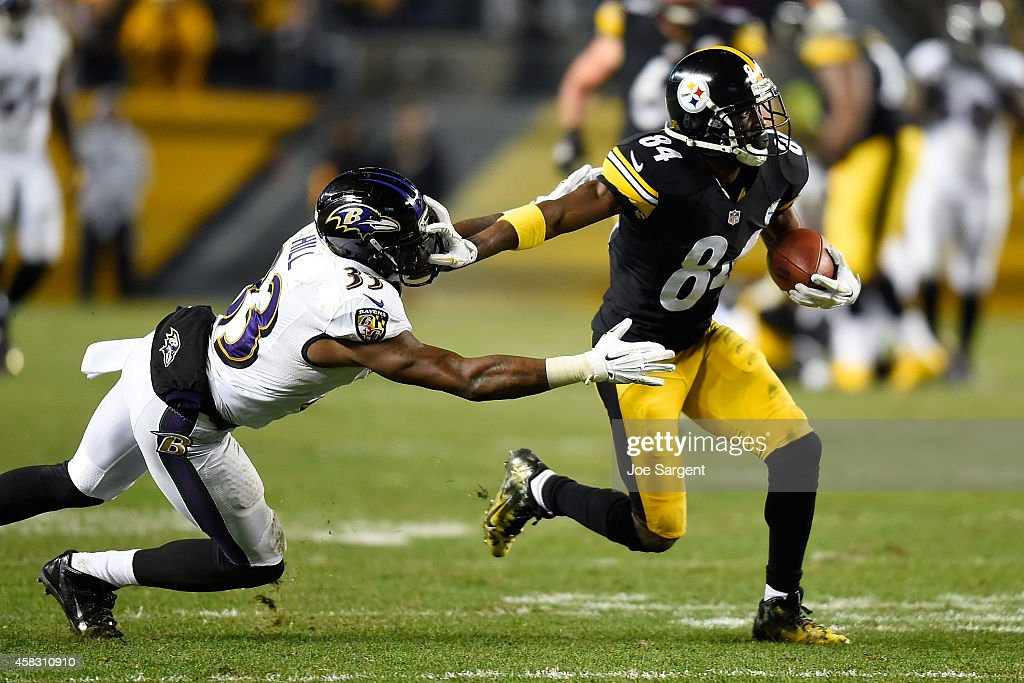 Antonio Brown #84 of the Pittsburgh Steelers breaks a tackle by Will Hill #33 of the Baltimore Ravens and scores a 54 yard touchdown during the fourth quarter at Heinz Field on November 2, 2014 in Pittsburgh, Pennsylvania.