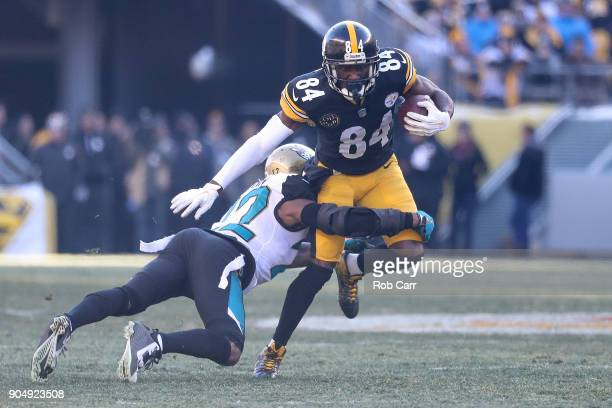 Antonio Brown of the Pittsburgh Steelers breaks a tackle from Barry Church of the Jacksonville Jaguars during the first half of the AFC Divisional...