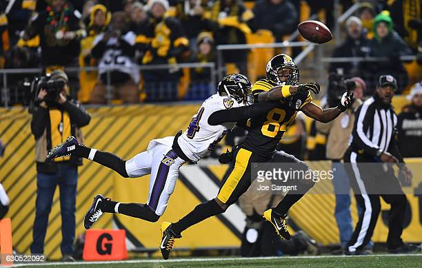 Antonio Brown of the Pittsburgh Steelers cannot make a catch while being defended by Shareece Wright of the Baltimore Ravens in the second half...