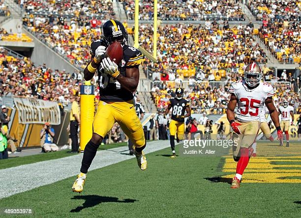 Antonio Brown of the Pittsburgh Steelers catches a 7 yard touchdown pass in the fourth quarter during the game against Eric Reid of the San Francisco...