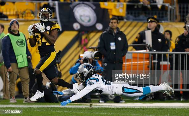 Antonio Brown of the Pittsburgh Steelers catches a pass in front of Donte Jackson of the Carolina Panthers for a 53 yard touchdown during the second...