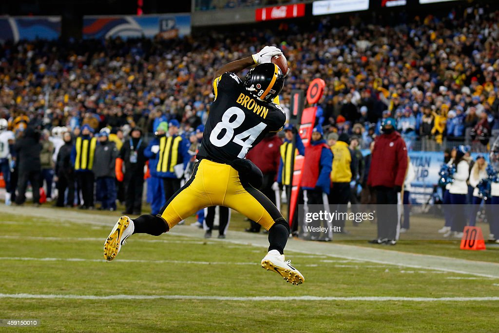 Antonio Brown #84 of the Pittsburgh Steelers catches a pass to run 12 yards for a touchdown against the Tennessee Titans in the fourth quarter of the game at LP Field on November 17, 2014 in Nashville, Tennessee. The Pittsburgh Steelers won 27-24.