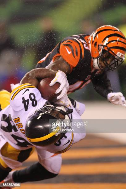 Antonio Brown of the Pittsburgh Steelers catches a touchdown pass as he is hit by George Iloka of the Cincinnati Bengals during the second half at...