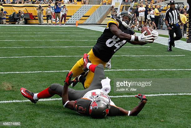 Antonio Brown of the Pittsburgh Steelers catches his second touchdown of the game in front of Alterraun Verner of the Tampa Bay Buccaneers during the...