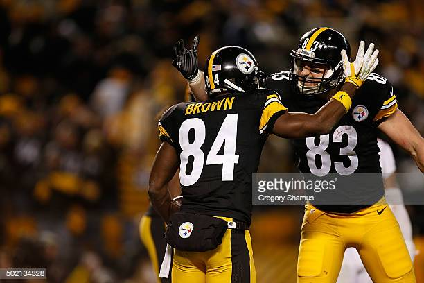 Antonio Brown of the Pittsburgh Steelers celebrates a touchdown in the fourth quarter with teammate Heath Miller during the game against the Denver...